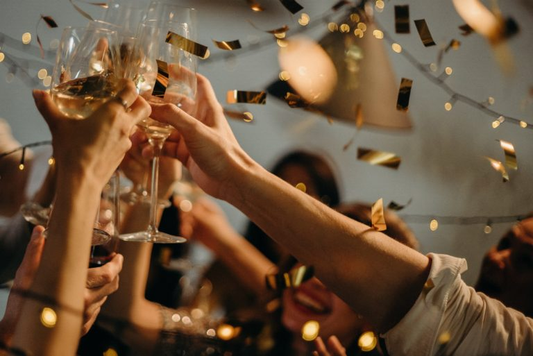 People holding glasses on a celebration toast