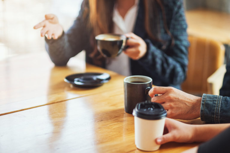 Picture of people drinking coffee while in conversation